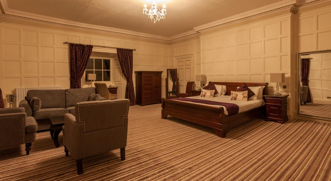 Wortley Hall Deluxe Suite Accommodation – Spacious Room with Double Bed and Sofas