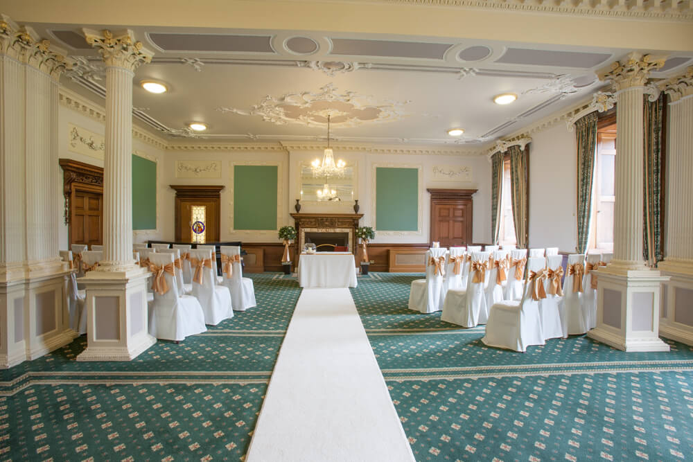 Room dressed for a wedding ceremony in Wortley Hall, Sheffield.
