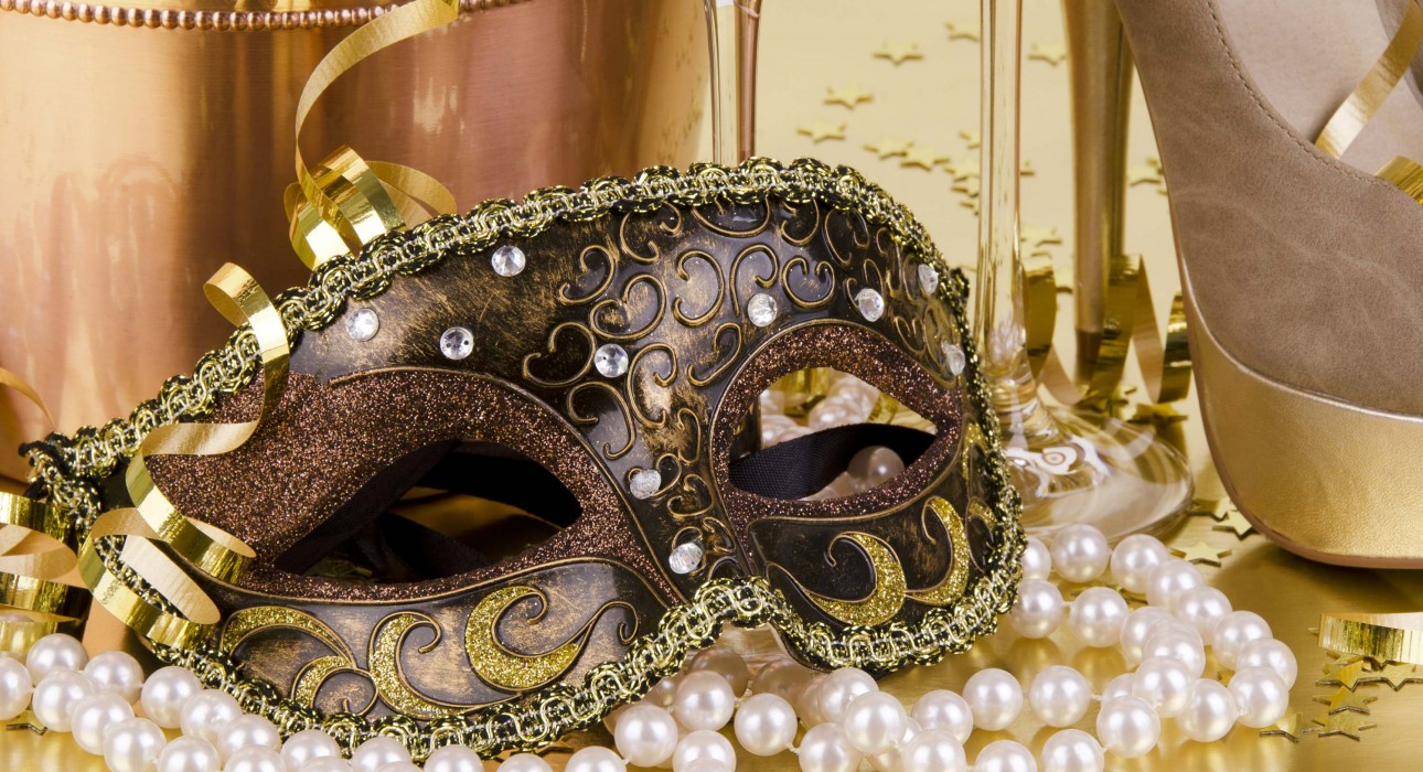 Masquerade mask and pearls.