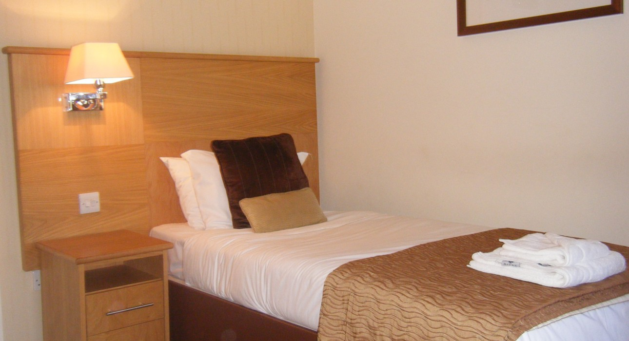 Luxury standard single bedroom with an en-suite bathroom at Wortley Hall, Sheffield.