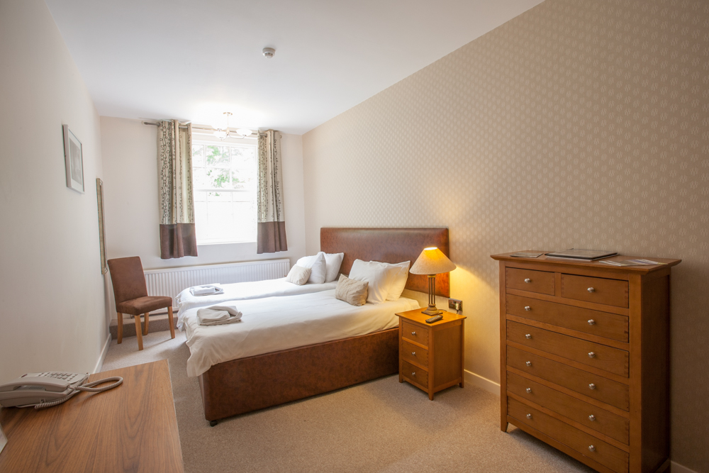 Luxury standard twin bedroom with an en-suite bathroom at Wortley Hall, Sheffield.