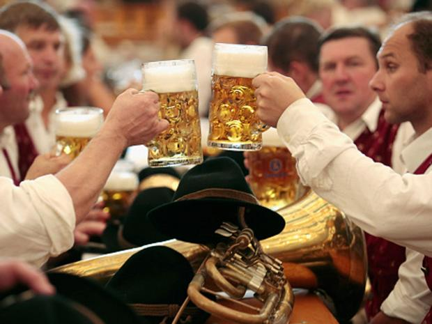 Men enjoying steins of beer.