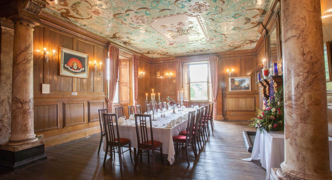 Wortley Hall dining room with long table and marble pillars